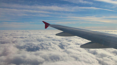 Looking On Wing And Sky From Airplane stock footage