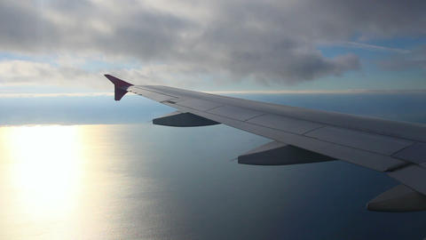looking on wing and sea from airplane Stock Video Footage