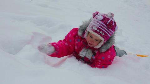 little girl playing in snow at winter Stock Video Footage