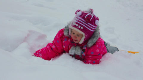 Little Girl Playing In Snow At Winter stock footage