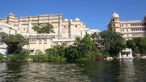 view from boat on lake and palaces in Udaipur Indi Stock Video Footage