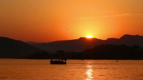 sunset on lake - Udaipur India Stock Video Footage