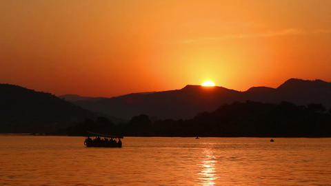 sunset on lake - Udaipur India Stock Video Footage