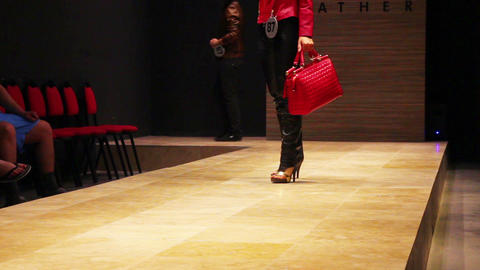 fashion models on podium - exhibition of leather Stock Video Footage