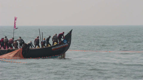 fishermen in boats pulling fishing nets - Kerala I Footage
