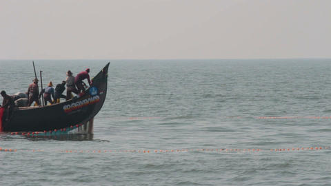 fishermen in boats pulling fishing nets - Kerala I Stock Video Footage