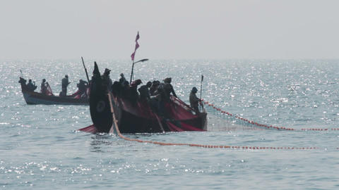 fishermen in boats pulling fishing nets - Kerala I Footage