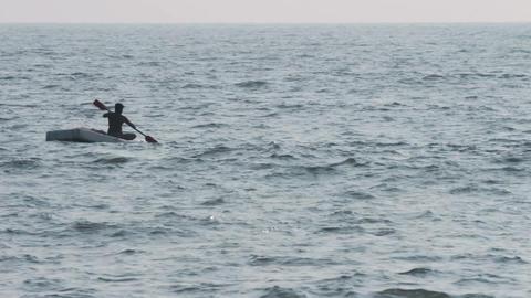 lone fisherman floating in sea on fishing - Kerala Stock Video Footage
