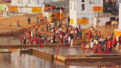 ritual bathing in holy lake - Pushkar India Footage