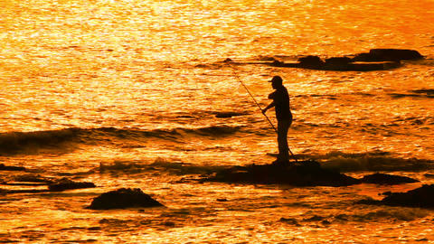 fisherman with spinning silhouette at sea sunset Stock Video Footage
