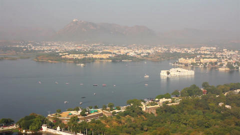 pan landscape with lake and palaces in Udaipur Ind Stock Video Footage
