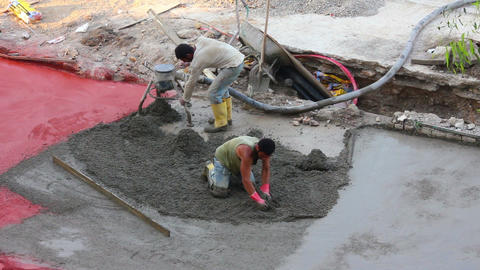 workers at construction site makes floor of concre Footage