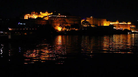 palace on lake in Udaipur India at night Stock Video Footage