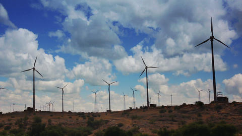 wind farm - turning windmills against timelapse cl Footage