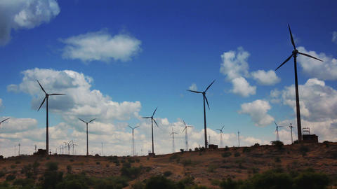 wind farm - turning windmills against timelapse cl Stock Video Footage