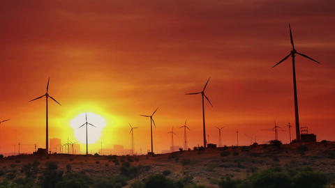 wind farm - turning windmills against timelapse su Stock Video Footage