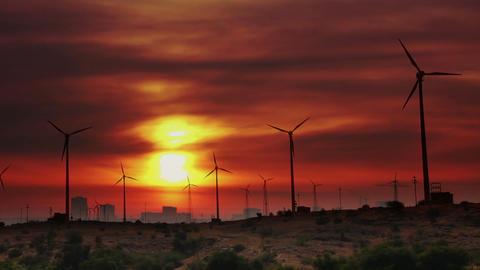 wind farm - turning windmills against timelapse su Stock Video Footage