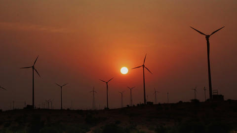 wind farm - turning windmills against timelapse su Footage