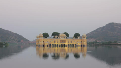 jal mahal palace on lake in Jaipur India at evenin Stock Video Footage
