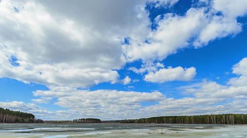 Clouds over the lake. Last snow. Fixed geometry Footage