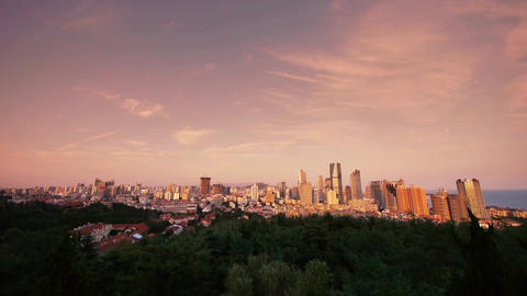 sunset glow of china urban skyline,QingDao(tsingtao) Stock Video Footage