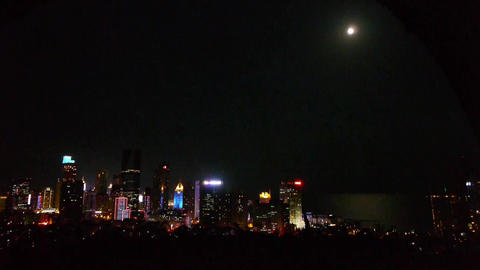 moon rising over urban skyline,china QingDao(tsingtao) Animation