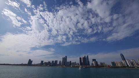 timelapse cloud,business building & sea skyline,busy sailboat & yacht Animation