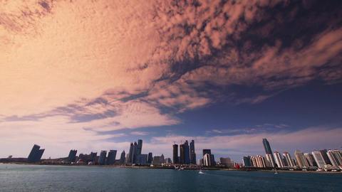 panoramic of sunset city skyline,sailboat & yacht on sea Stock Video Footage