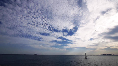 sailboat on sea with cloud Stock Video Footage