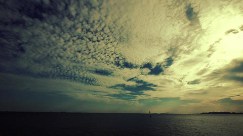 timelapse sailboat on sea,sunset clouds Stock Video Footage