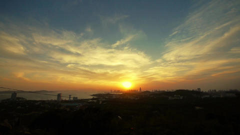 timelapse sunset clouds,seaside urban skyline & forest Stock Video Footage