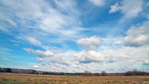 Clouds over the field. Early Spring Stock Video Footage