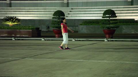 Hanoi - Evening exercise - Walking backward Stock Video Footage