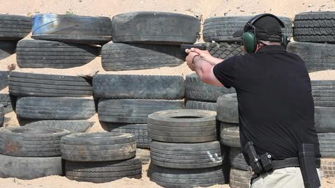 man shoots a gun Stock Video Footage