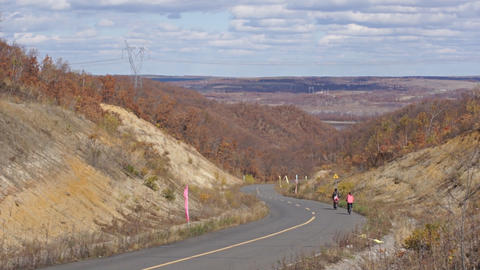 Autumn road and two bikers Stock Video Footage