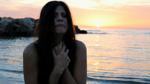 Closeup of sad lonely woman crying during sunset on the beach Animation