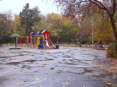 Children's playground in the fall. It's snowing, E Stock Video Footage