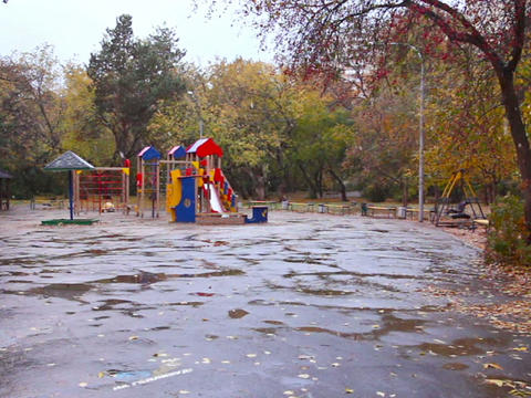 Children's playground in the fall. It's snowing, E Footage