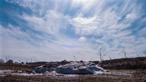 A pile of snow melts in the sun Stock Video Footage