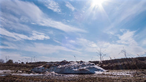 A pile of snow melts in the sun Footage