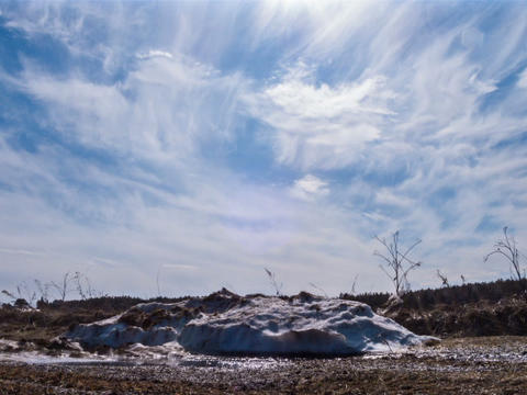 Pile of snow melts in the sun. Time Lapse Footage