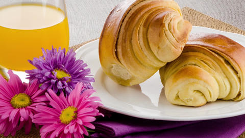 Croissants with orange juice Stock Video Footage