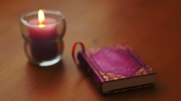 Romantic Book and Candle Rack Focus Stock Video Footage