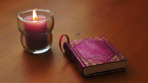 Romantic Book and Candle Rack Focus Footage