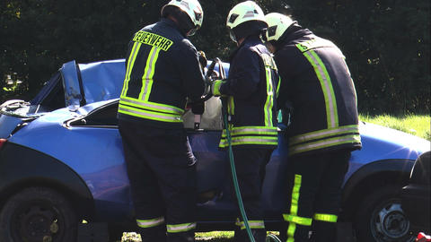 firefighter using hydraulic cutter (jaws of life) Stock Video Footage