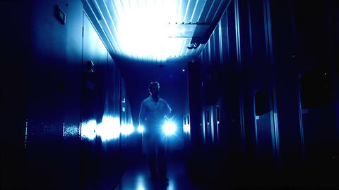 Scientist in data center in blue Stock Video Footage