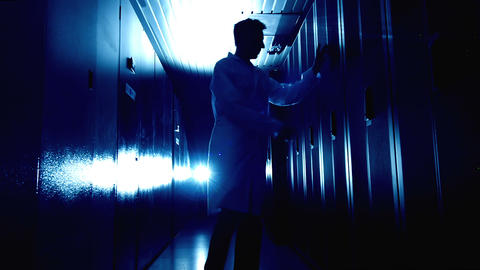Scientist in data center in blue Footage