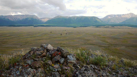 Stone mound against steppe and mountains Stock Video Footage