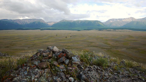 Stone mound against steppe and mountains Footage