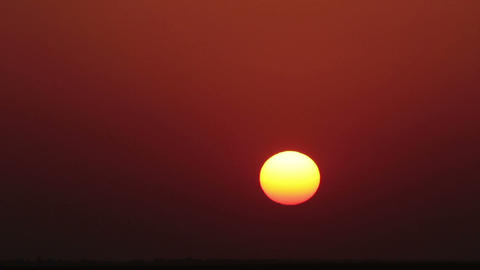 timelapse with red sunset in desert Stock Video Footage